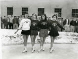 Four ice skaters