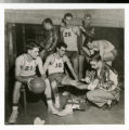 Bethel basketball players in locker room with trainer