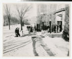Students coming and going in front of Bethel College building on Snelling Campus during winter