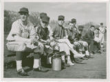 Men's baseball players seated on bench