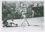 Men's baseball player swinging at bat