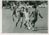 Men's soccer players fighting for control of the ball