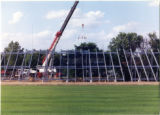 Press box being hoisted into position on new bleachers 1