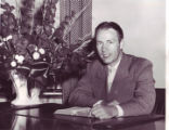 Carl Lundquist at his desk