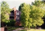 Outside shot of Arden Village East, surrounded by trees