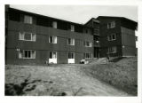 Exterior view of Arden Village West, buildings K and L, two students in front
