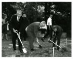 Three men working with shovels at Groundbreaking Ceremony