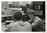 Male and Female student studying in library