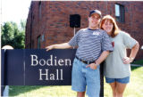 Male and Female student in front of Bodien Hall sign