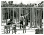Five men laying beams for Nelson Hall rooms