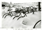 Bicycles buried in the snow