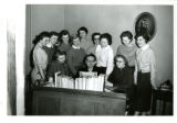 Bodien dorm council, group of female students at piano