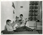 Two male students studying in dormitory room (Edgren residence)