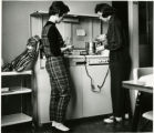 Two female students at (dormitory) stove