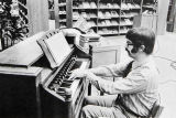 Doc Dalton playing the organ for chapel in the library 1973