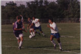 Men's Soccer running toward the goal