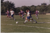 Men's Soccer running to the Ball