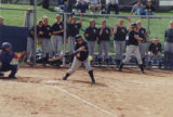 Softball player batting about to hit the ball