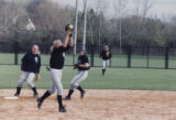Softball player catching a fly ball